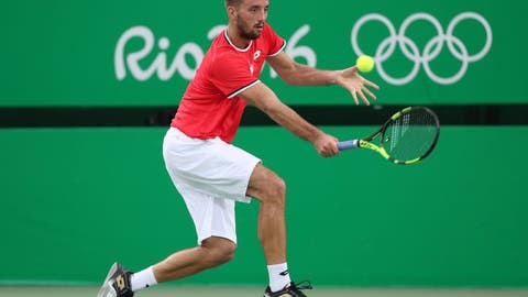 Aug 7, 2016; Rio de Janeiro, Brazil; Viktor Troicki (SRB) looks on during his match against Andy Murray (GBR, not pictured) in the Rio 2016 Summer Olympic Games at Olympic Tennis Centre. Mandatory Credit: Jeff Swinger-USA TODAY Sports