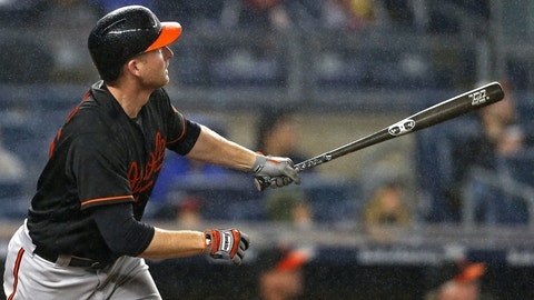 Sep 30, 2016; Bronx, NY, USA; Baltimore Orioles right fielder Mark Trumbo (45) hits a 2-run home run during the fifth inning against the New York Yankees at Yankee Stadium. Mandatory Credit: Adam Hunger-USA TODAY Sports