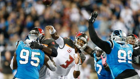 Oct 10, 2016; Charlotte, NC, USA;  Tampa Bay Buccaneers quarterback Jameis Winston (3) throws the ball as Carolina Panthers defensive end Mario Addison (97) defends during the second quarter at Bank of America Stadium. Mandatory Credit: Jeremy Brevard-USA TODAY Sports