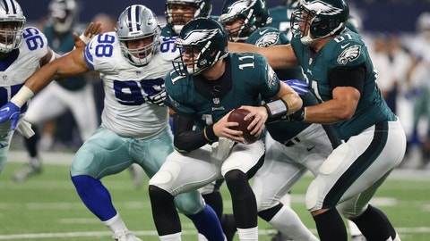 Oct 30, 2016; Arlington, TX, USA; Philadelphia Eagles quarterback Carson Wentz (11) is sacked by Dallas Cowboys defensive end Tyrone Crawford (98) in the second quarter at AT&T Stadium. Mandatory Credit: Matthew Emmons-USA TODAY Sports