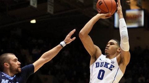 Dec 3, 2016; Durham, NC, USA; Duke Blue Devils forward Jayson Tatum (0) shoots over Maine Black Bears guard Ilker Er (21) in the second half of their game at Cameron Indoor Stadium. Mandatory Credit: Mark Dolejs-USA TODAY Sports
