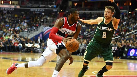 Dec 10, 2016; Washington, DC, USA; Washington Wizards guard John Wall (2) dribbles as Milwaukee Bucks guard Matthew Dellavedova (8) defends during the second half at Verizon Center. Washington Wizards won 110-105. Mandatory Credit: Brad Mills-USA TODAY Sports