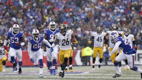 Dec 11, 2016; Orchard Park, NY, USA;  Pittsburgh Steelers running back Le'Veon Bell (26) runs the ball during the second half against the Buffalo Bills at New Era Field. Pittsburgh beat Buffalo 27-20. Mandatory Credit: Timothy T. Ludwig-USA TODAY Sports