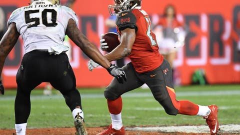 Dec 11, 2016; Tampa, FL, USA;    Tampa Bay Buccaneers running back Doug Martin (22) runs the ball in the second half against  the New Orleans Saints  at Raymond James Stadium. The Tampa Bay Buccaneers defeated the New Orleans Saints 16-11. Mandatory Credit: Jonathan Dyer-USA TODAY Sports