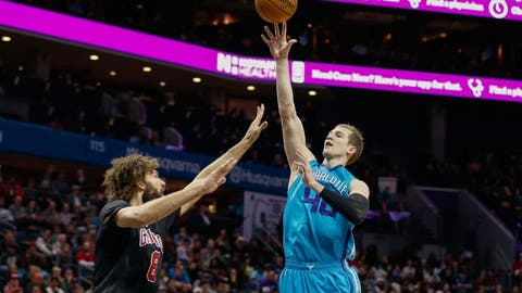 Dec 23, 2016; Charlotte, NC, USA; Charlotte Hornets center Cody Zeller (40) shoots the ball over Chicago Bulls center Robin Lopez (8) during the first half at Spectrum Center. Mandatory Credit: Jeremy Brevard-USA TODAY Sports
