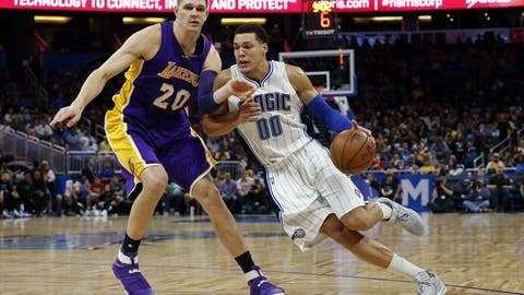 Dec 23, 2016; Orlando, FL, USA; Orlando Magic forward Aaron Gordon (00) drives to the basket as Los Angeles Lakers center Timofey Mozgov (20) defends during the second half at Amway Center.Orlando Magic defeated the Los Angeles Lakers 109-90.  Mandatory Credit: Kim Klement-USA TODAY Sports