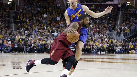 Dec 25, 2016; Cleveland, OH, USA; Cleveland Cavaliers guard Kyrie Irving (2) drives to the basket against Golden State Warriors forward Klay Thompson (11) at Quicken Loans Arena. Cleveland defeats Golden State 109-108. Mandatory Credit: Brian Spurlock-USA TODAY Sports