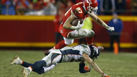 Dec 25, 2016; Kansas City, MO, USA;  Kansas City Chiefs tight end Travis Kelce (87) is tackled by Denver Broncos free safety Justin Simmons (31) during the second half at Arrowhead Stadium. The Chiefs won 33-10. Mandatory Credit: Jay Biggerstaff-USA TODAY Sports