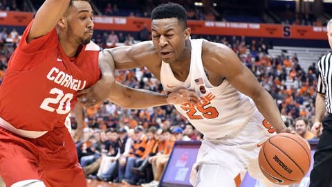Dec 27, 2016; Syracuse, NY, USA; Syracuse Orange guard Tyus Battle (25) drives the ball on the baseline as Cornell Big Red guard Wil Bathurst (20) defends during the second half of a game at the Carrier Dome. Syracuse won 80-56. Mandatory Credit: Mark Konezny-USA TODAY Sports