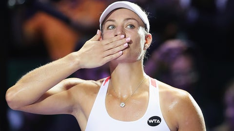 SINGAPORE - OCTOBER 23:  Angelique Kerber of Germany celebrates victory in her singles match against Dominika Cibulkova of Slovakia during day 1 of the BNP Paribas WTA Finals Singapore at Singapore Sports Hub on October 23, 2016 in Singapore.  (Photo by Matthew Stockman/Getty Images for WTA)