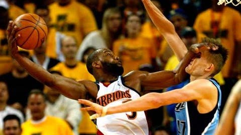 Stiff-arming an opponent's face while dunking on him