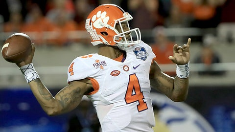 ORLANDO, FL - DECEMBER 03:  Deshaun Watson #4 of the Clemson Tigers attempts a pass during the ACC Championship game against the Virginia Tech Hokies on December 3, 2016 in Orlando, Florida.  (Photo by Sam Greenwood/Getty Images)