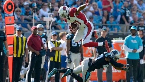 The Cardinals' David Johnson goes airborne for some extra yardage
