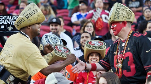 Notice the Saints fan at left going for the pound while the 49ers tries for a handshake