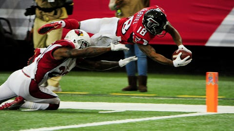 Falcons receiver Taylor Gabriel leaps inside the pylon