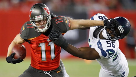 Bucs wideout Adam Humphries gives Cliff Avril a hand sandwich