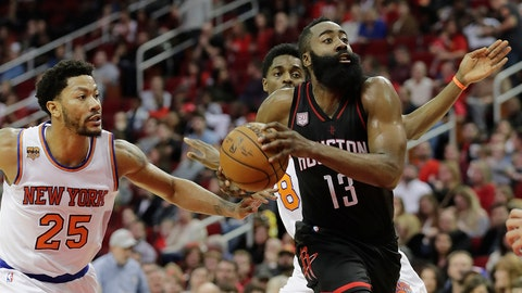 HOUSTON, TX - DECEMBER 31:  James Harden #13 of the Houston Rockets drives to the basket defended by Derrick Rose #25 of the New York Knicks in the first half at Toyota Center on December 31, 2016 in Houston, Texas. NOTE TO USER: User expressly acknowledges and agrees that, by downloading and or using this photograph, User is consenting to the terms and conditions of the Getty Images License Agreement.  (Photo by Tim Warner/Getty Images)