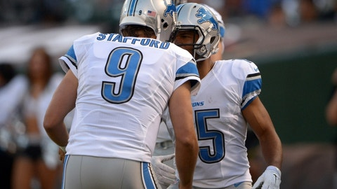 Aug 15, 2014; Oakland, CA, USA; Detroit Lions quarterback Matthew Stafford (9) and receiver Golden Tate (15) celebrate after a touchdown against the Oakland Raiders at O.co Coliseum. Mandatory Credit: Kirby Lee-USA TODAY Sports