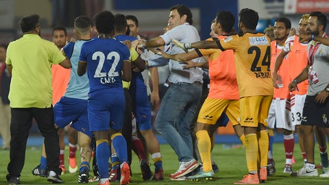 Mumbai City FC players and Athletico de Kolkata players scuffle after the Indian Super League (ISL) second leg semi-final football match between Mumbai City FC and Athletico de Kolkata at The Mumbai Football Arena Stadium in Mumbai on December 13, 2016.  ----IMAGE RESTRICTED TO EDITORIAL USE - STRICTLY NO COMMERCIAL USE----- / AFP / INDRANIL MUKHERJEE / ----IMAGE RESTRICTED TO EDITORIAL USE - STRICTLY NO COMMERCIAL USE-----        (Photo credit should read INDRANIL MUKHERJEE/AFP/Getty Images)