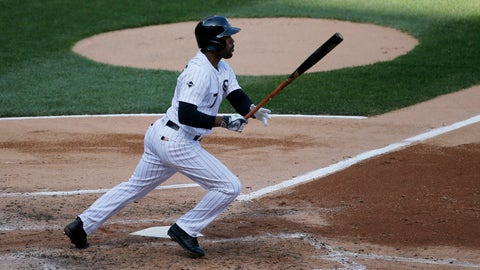 Chicago White Sox's Jimmy Rollins watches his RBI single off Cleveland Indians starting pitcher Mike Clevinger, scoring Austin Jackson, during the third inning of a baseball game Monday, May 23, 2016, in Chicago. (AP Photo/Charles Rex Arbogast)