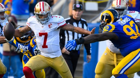 Dec 24, 2016; Los Angeles, CA, USA; San Francisco 49ers quarterback Colin Kaepernick (7) tries to elude Los Angeles Rams defensive tackle Quinton Dial (right) during the first half at Los Angeles Memorial Coliseum. Mandatory Credit: Robert Hanashiro-USA TODAY Sports