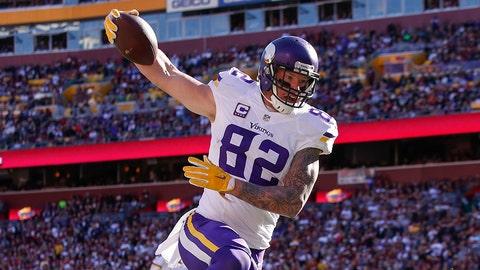 Minnesota Vikings tight end Kyle Rudolph (82) leaps over Washington Redskins cornerback Josh Norman (24) during the first half of an NFL football game in Landover, Md., Sunday, Nov. 13, 2016. (AP Photo/Alex Brandon)