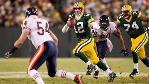 Green Bay Packers quarterback Aaron Rodgers (12) scrambles during a week 16 NFL football game against the Chicago Bears on December 25, 2011 in Green Bay, Wisconsin. The Packers won 35-21. (AP Photo/David Stluka)