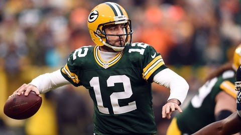 GREEN BAY, WI - DECEMBER 11:  Aaron Rodgers #12 of the Green Bay Packers drops back to pass during a game against the Seattle Seahawks at Lambeau Field on December 11, 2016 in Green Bay, Wisconsin.  The Packers defeated the Seahawks 38-10.  (Photo by Stacy Revere/Getty Images)