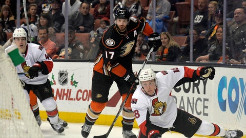 December 11, 2016; Anaheim, CA, USA; Ottawa Senators left wing Ryan Dzingel (18) turns the puck over in front of Anaheim Ducks center Ryan Kesler (17) during the third period at Honda Center. (Gary A. Vasquez-USA TODAY Sports)