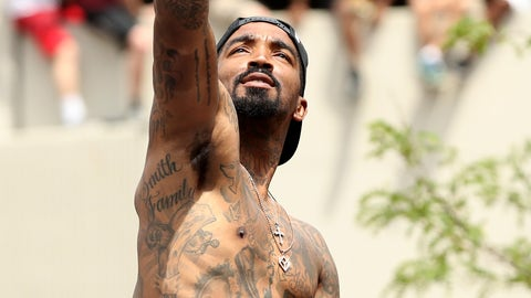 A shirtless J.R. Smith celebrated at the Cavaliers' championship parade in Cleveland