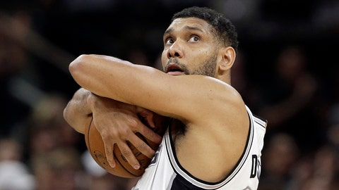 FILE - In this April 30, 2016, file photo, San Antonio Spurs forward Tim Duncan holds the ball during the first half in Game 1 of a second-round NBA basketball playoff series against the Oklahoma City Thunder in  San Antonio. A former financial adviser for retired Spurs star Tim Duncan is facing fraud charges over millions of dollars in lost investments.  Charles Banks of Atlanta was arrested Friday, Sept. 9, 2016, in San Antonio on two counts of wire fraud. Banks appeared in federal court and was freed on bond.  (AP Photo/Eric Gay, File)