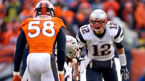 DENVER, CO - JANUARY 24: Tom Brady #12 of the New England Patriots looks on from the line of scrimmage in the second quarter against  Von Miller #58 of the Denver Broncos in the AFC Championship game at Sports Authority Field at Mile High on January 24, 2016 in Denver, Colorado.  (Photo by Doug Pensinger/Getty Images)