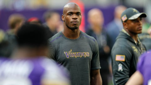 Injured Minnesota Vikings running back Adrian Peterson stands on the sidelines during the first half of an NFL football game against the Detroit Lions Sunday, Nov. 6, 2016, in Minneapolis. (AP Photo/Andy Clayton-King)