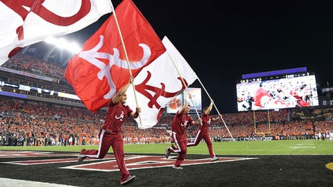 Jan 9, 2017; Tampa, FL, USA; Alabama Crimson Tide cheerleaders run flags in the end zone after a touchdown during the first quarter against the Clemson Tigers in the 2017 College Football Playoff National Championship Game at Raymond James Stadium. Mandatory Credit: John David Mercer-USA TODAY Sports