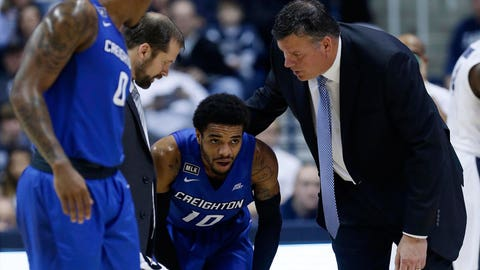Jan 16, 2017; Cincinnati, OH, USA; Creighton Bluejays head coach Greg McDermott (right) checks on guard Maurice Watson Jr. (10) during the first half against the Xavier Musketeers at the Cintas Center. Creighton won 72-67. Mandatory Credit: Frank Victores-USA TODAY Sports