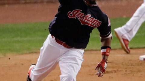 Cleveland Indians' Rajai Davis celebrates after his two run home run against the Chicago Cubs during the eighth inning of Game 7 of the Major League Baseball World Series Wednesday, Nov. 2, 2016, in Cleveland. (AP Photo/Charlie Riedel)