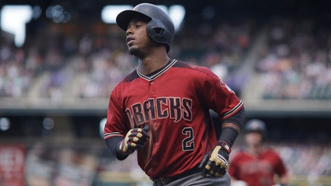 FILE - In this Sept. 4, 2016, file photo, Arizona Diamondbacks' Jean Segura heads back to the dugout after scoring against the Colorado Rockies in a baseball game in Denver. Seattle and Arizona pulled off a five-player trade Wednesday night, Nov. 23, with the Mariners acquiring speedy infielder Segura and the Diamondbacks getting right-hander Taijuan Walker as the centerpieces of the deal. (AP Photo/David Zalubowski, File)