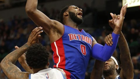 Detroit Pistons center Andre Drummond (0) is fouled by Minnesota Timberwolves forward Jordan Hill (27) in the second half of an NBA basketball game Friday, Dec. 9, 2016, in Minneapolis. Detroit won 117-90. (AP Photo/Stacy Bengs)