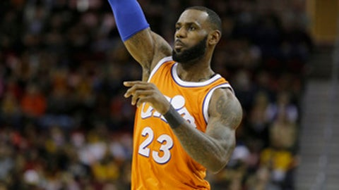 Cleveland Cavaliers' LeBron James passes against the Miami Heat in the first half of an NBA basketball game Friday, Dec. 9, 2016, in Cleveland. (AP Photo/Tony Dejak)