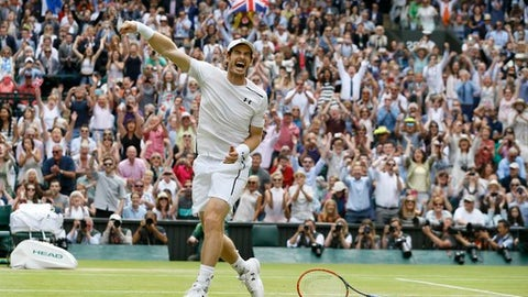 FILE - In this Sunday, July 10, 2016 file photo Andy Murray of Britain celebrates after beating Milos Raonic of Canada in the men's singles final on day fourteen of the Wimbledon Tennis Championships in London. (AP Photo/Kirsty Wigglesworth, File)