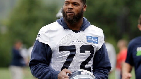 FILE - In this July 30, 2016, file photo, Seattle Seahawks' Michael Bennett walks on the field during NFL football training camp in Renton, Wash. Bennett and the Seahawks reached agreement on a three-year contract extension on Friday, Dec. 30, 2016,  that will keep the defensive end under contract through the 2020 season. (AP Photo/Elaine Thompson, File)