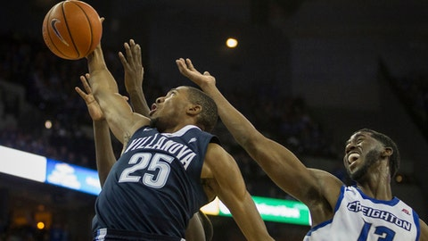 Villanova guard Mikal Bridges (25) gets the rebound ahead of Creighton forward Cole Huff (13) during the second half of an NCAA college basketball game in Omaha, Neb., Saturday, Dec. 31, 2016. Villanova defeated Creighton 80-70. (AP Photo/John Peterson)