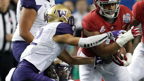 Alabama defensive lineman Jonathan Allen (93) runs after recovering a fumble as Washington wide receiver Aaron Fuller (12) defends during the first half of the Peach Bowl NCAA college football playoff game, Saturday, Dec. 31, 2016, in Atlanta. (AP Photo/John Bazemore)