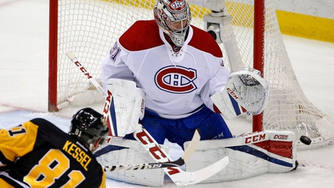 Pittsburgh Penguins' Phil Kessel (81) has a shot blocked by Montreal Canadiens goalie Carey Price (31) during the first period of an NHL hockey game in Pittsburgh, Saturday, Dec. 31, 2016. (AP Photo/Gene J. Puskar)