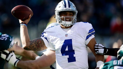 Dallas Cowboys' Dak Prescott passes during the first half of an NFL football game against the Philadelphia Eagles, Sunday, Jan. 1, 2017, in Philadelphia. (AP Photo/Matt Rourke)