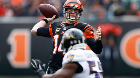 Cincinnati Bengals quarterback Andy Dalton (14) passes in the first half of an NFL football game against the Baltimore Ravens, Sunday, Jan. 1, 2017, in Cincinnati. (AP Photo/Gary Landers)