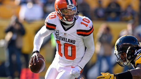 Cleveland Browns quarterback Robert Griffin III (10) rolls out under pressure by Pittsburgh Steelers defensive tackle L.T. Walton (96) during the first half of an NFL football game in Pittsburgh, Sunday, Jan. 1, 2017. (AP Photo/Don Wright)