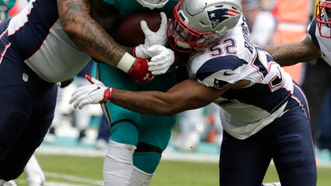 New England Patriots defensive tackle Alan Branch (97)and outside linebacker Elandon Roberts (52) bring tackle Miami Dolphins running back Jay Ajayi (23), during the first half of an NFL football game, Sunday, Jan. 1, 2017, in Miami Gardens, Fla. (AP Photo/Lynne Sladky)