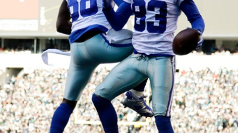Dallas Cowboys' Terrance Williams (83) and Dez Bryant (88) celebrate after a touchdown by Williams during the first half of an NFL football game against the Philadelphia Eagles, Sunday, Jan. 1, 2017, in Philadelphia. (AP Photo/Matt Rourke)