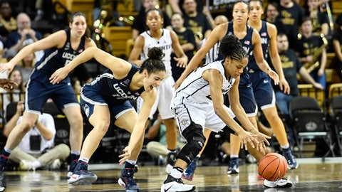 Central Florida guard Aliyah Gregory (22) fights to keep possession away from Connecticut guard Kia Nurse (11) during the first half of an NCAA college basketball game, Sunday, Jan. 1, 2017, in Orlando, Fla. (AP Photo/Roy K. Miller)